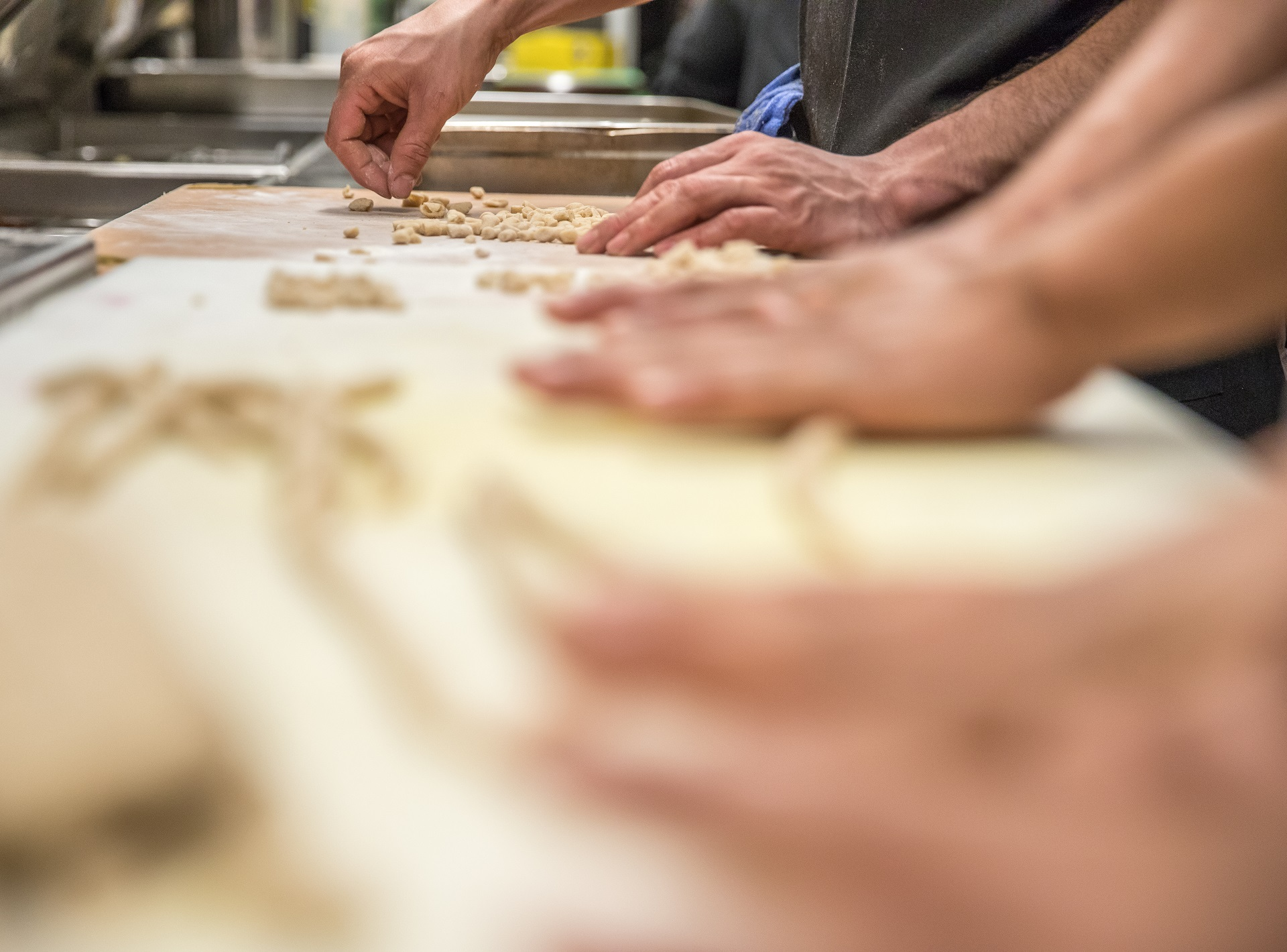 Close up of hands making pasta